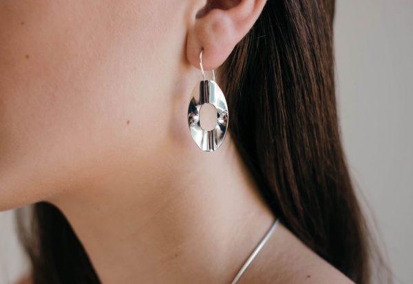 Model wearing Mirage Medium Hook Earrings by Black Matter