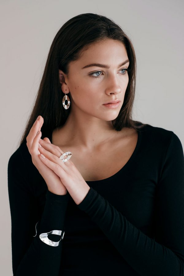 Model wearing the Mirage Earrings with the Mirage Cuff and Tall Ring by Black Matter
