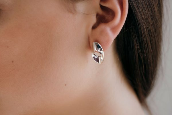 Model wearing the Small Mirage Stud Earrings by Black Matter
