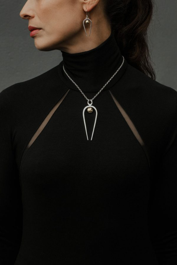 Black Matter co-founder Amy Cunningham, wearing the Penumbra Large Pendant and Penumbra Earrings