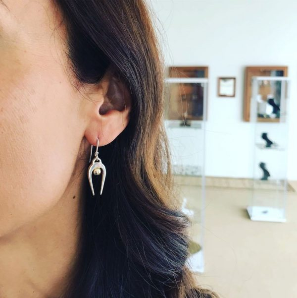 Black Matter co-founder Amy, wearing the Penumbra Small Drop Earrings