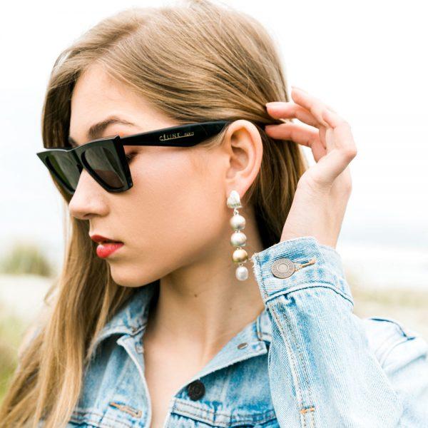 Model wearing the Local Palette Arctic Drop earrings by Black Matter