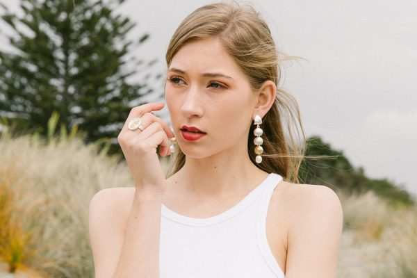 Model wearing the Local Palette Ring and Arctic Drop earrings by Black Matter Jewellery