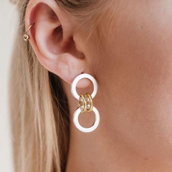 Model wearing the Forte Dual Gold-Link Earrings by Black Matter Jewellery