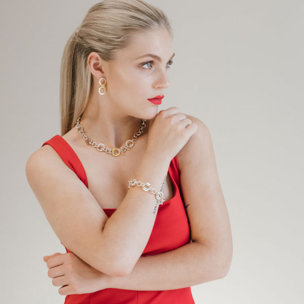 Model wearing the Forte Dual Gold-Link Earrings, Round Gold-link Necklace and Swage Bracelet by Black Matter Jewellery