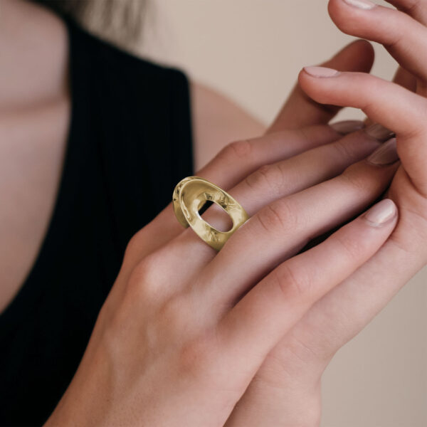 Model wearing the Mirage Gold Tall Ring by Black Matter