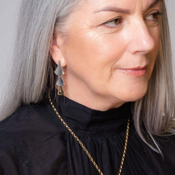 Model wearing the Emergence Dual Tone Cascade Earrings by Black Matter